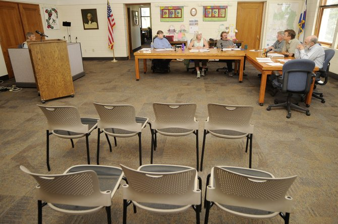 Routt County officials discuss a temporary moratorium on new medical marijuana businesses Tuesday in the Commissioners Hearing Room. No members of the public showed up to speak at the meeting.
