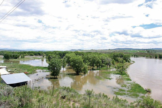 Water from the Yampa River is shown flooded into an adjacent field Wednesday near Colorado Highway 13, south of Craig. National Weather Service officials said the Yampa's faster-than-average flow peaked Wednesday and will decrease throughout the rest of the week.