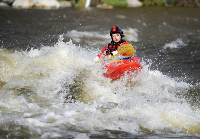 Kai Franken, 8, son of Rick and Cyd Franken, of Steamboat Springs, plows through the C-Hole on the Yampa River on Tuesday afternoon. Tuesday morning was the second time in the past three days that the Yampa River reached a seven-year high.