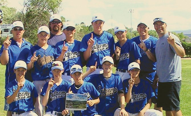 The Summit Extreme 13-and-under AA baseball team, comprised of members from Summit and Routt counties, celebrate after finishing third at a Triple Crown tournament in Grand Junction.