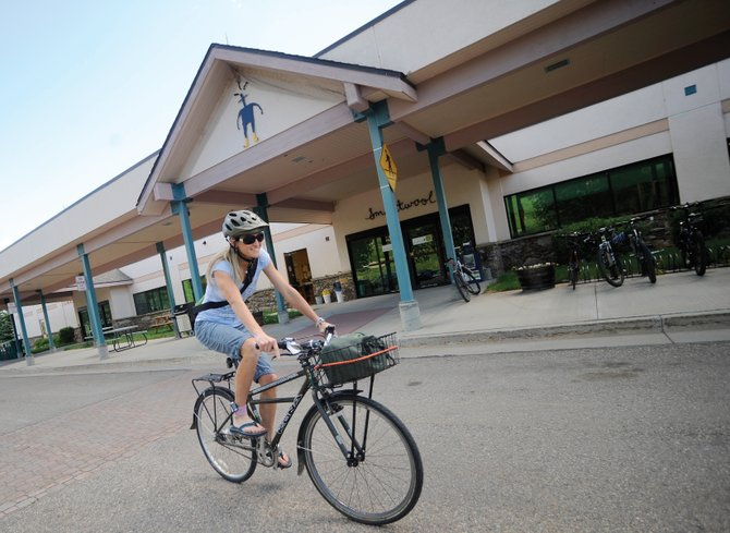 SmartWool employee Marla Bailey leaves work on her bike Thursday.