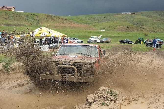 Robert Hinkson makes his way through the pit during the Moffat County Mud Runs on Saturday at Wyman Museum. Racers said the rainy conditions were fitting for the mucky event. For a story on the event with photos, see sports on page 9.
