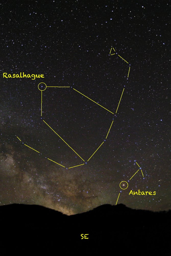 The bright star Rasalhague marks the head of Ophiuchus, the mythological witch doctor. Look for him holding his pet snake high in the southeastern sky at about 10 p.m. this month, hovering over the stars of Scorpius the Scorpion.