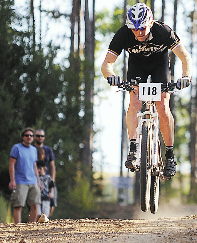 Pat West catches some air as he races toward the finish line last summer during a Town Challenge race at Steamboat Ski Area. The ski area announced this week that it is moving forward with plans to build new downhill-only mountain biking trails.