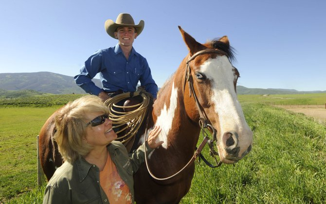 Routt County resident Connie Cassel adopted one of the rescue horses from the recently formed Rescued to Ride organization. Whispering Willows Ranch trainer Scott Whinfrey worked with the horse named Cayenne to prepare it for adoption.