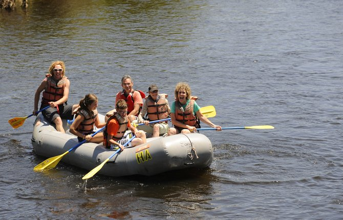 The Bauman family floats down the Yampa River on Tuesday during a Bucking Rainbow Outfitters rafting trip.