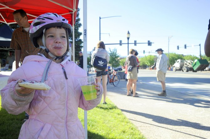 Six-year-old Liesel Wilkinson, daughter of Jen Wilkinson, has breakfast Wednesday morning after a bike ride in front of the Routt County Courthouse. Honey Stinger and Big Agnes sponsored the free breakfast event as part of Bike to Work Week.