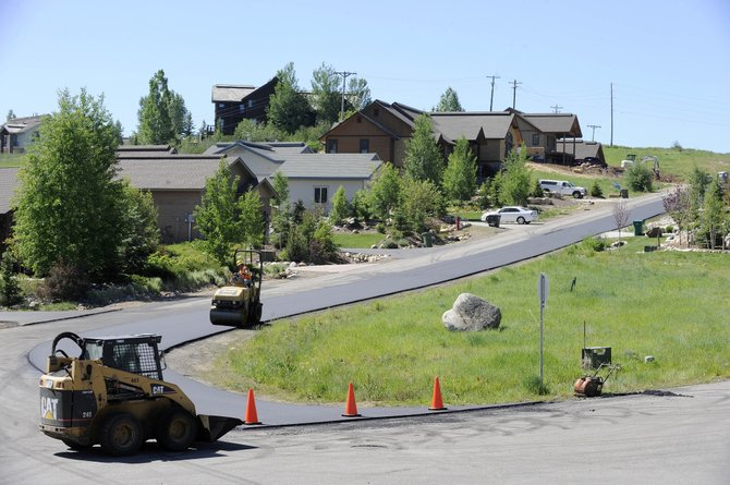 A crew works on paving a road Wednesday in the Longview Highlands subdivision off Hilltop Parkway. Census estimates indicate that Steamboat's population increased more than 2,300 from 2000 to 2009