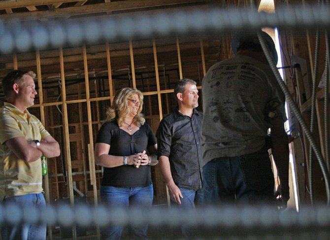 Jason and Tracey Haskell, center, founders of the New Creation Church, talk with contractors about progress on the church's new building Monday at 520 Westridge Road. The church's new building will be 6,000 square feet and will cost $1.2 million. It is on schedule to be completed in September.