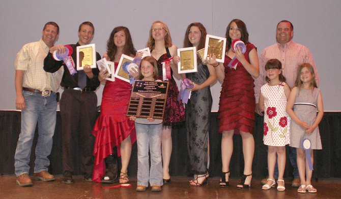 The Routt County 4-H Livestock Judging Team won the state competition June 23 in Fort Collins for the first time. Pictured are, back row, from left, coach Rod Wille, Cole Carnahan, Catharine Koroulis, Abbey Horn, Morgan Hatfield, Mackenzie Carnahan and coach Rod Olinger. Front row, from left, are Kayla Wille, Grace Olinger and Katelyn Olinger.