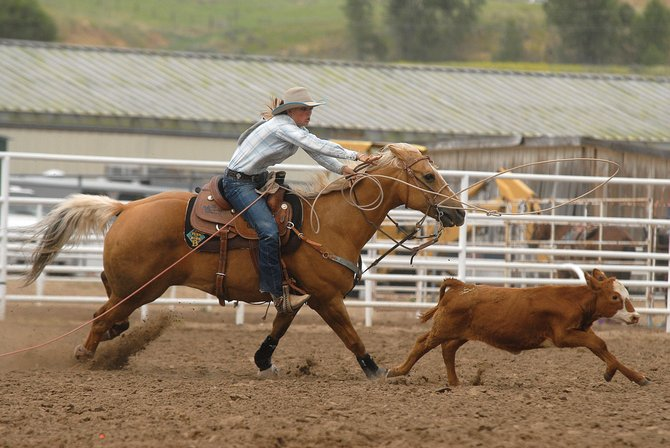 Taylor Vernon tries to snag a calf during Thursday's senior girls breakaway roping. The Little Britches Rodeo will continue at 9 a.m. today at the Moffat County Fairgrounds, 640 E. Victory Way.