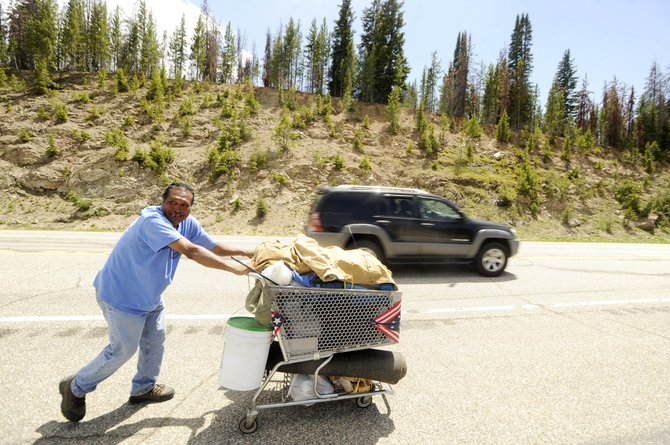 David Muniz pushes his shopping cart Friday along U.S. Highway 40 on Rabbit Ears Pass.