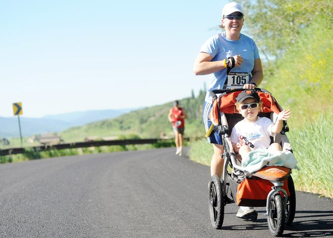 Will, 2, waves as his mother, Steamboat Springs resident Robin Hall, runs on Saturday in the Mountain Madness 10-kilometer race in Steamboat. About 230 runners showed up for the event, which helped kick off a busy weekend of activities across town.