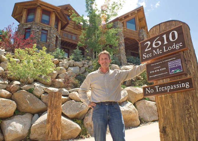 Robin Craigen, owner of Moving Mountain Chalets, stands in front of one of the homes he manages in Steamboat Springs.