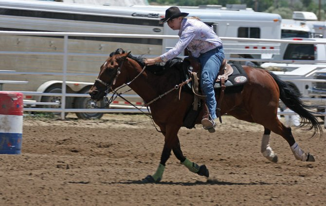 Taylor Duzik runs her horse through the finish line of the barrel race during Sunday's Little Britches Rodeo at the Moffat County Fairgrounds. The four-day rodeo began Thursday and finished Sunday.
