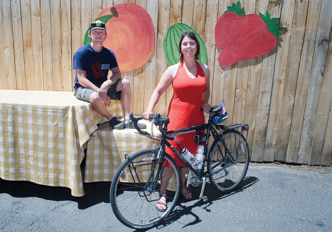 Cyclist Charlie Preston-Townsend, back, and Spela Bertoncelj are peddling their bikes cross-country to raise awareness of locally grown and produced food and alternative modes of transportation. Another cyclist, Andy Boslett, also is making the ride but is not pictured.