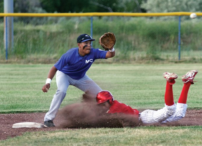 Shortstop Carlos Maldonado tries to cover second base during an American Legion baseball game against Steamboat Springs on Tuesday at Craig Middle School. The Bulldogs lost the first game of the doubleheader 7-3.