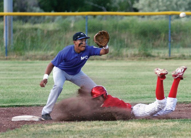 Shortstop Carlos Maldonado tries to cover second base during an American Legion baseball game against Steamboat Springs on Tuesday at Craig Middle School. Steamboat won the first game of the doubleheader, 7-3.