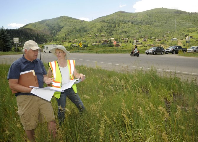 City of Steamboat Springs Project Manager Laura Anderson and Bob Furman, with Civil Design Consultants, discuss plans Tuesday for a new trail connection on the Mount Werner Road underpass. City Council voted unanimously Tuesday night to spend $91,187 from its 2010 capital budget to match grants in support of a new urban trail that would link existing trails beneath the Mount Werner Road underpass.