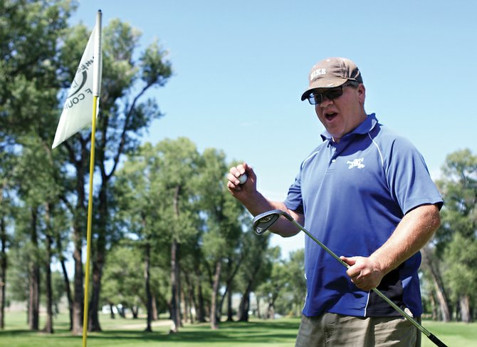 Tim Boyle re-creates his expression after he recently sunk a hole-in-one. Boyle, Yampa Valley Golf Course superintendent, sunk his ace on July 1 on hole 4.