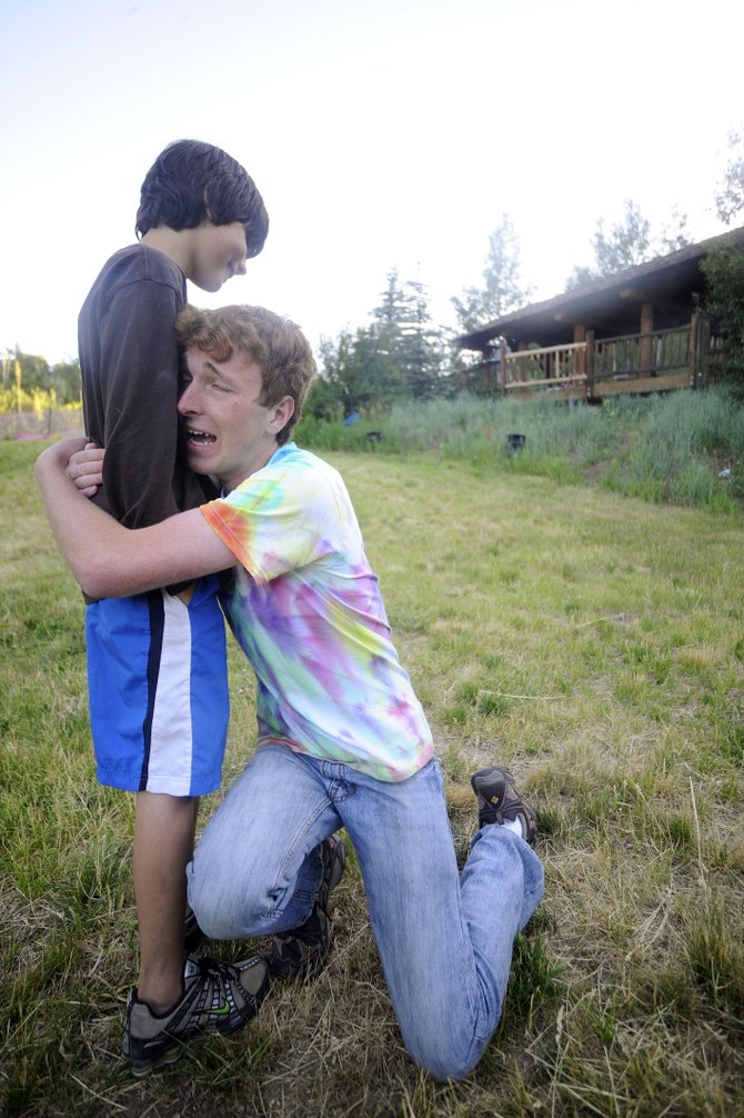 """Justin Doerr, 17, right, says goodbye to his cow, played by 11-year-old Iain Grant, during a rehearsal for """"Into the Woods"""" on Tuesday at Spring Creek Park. The play is being performed at 6 p.m. today."""