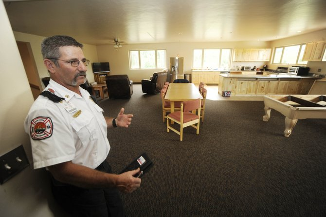 Oak Creek Fire Chief Chuck Wisecup talks Wednesday about the living quarters recently completed at the Stagecoach Fire Station.