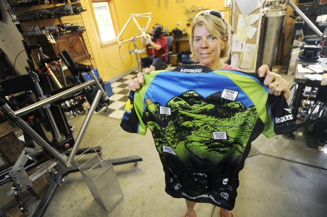 Katie Lindquist displays the 2010 Tour de Steamboat jersey that illustrates the long course, which is more than 100 miles and includes three mountain passes. The July 17 ride benefits the Sunshine Kids organization.