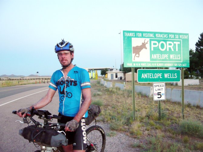 Erik Lobeck stands exhausted after finishing the nearly 3,000 mile Tour Divide mountain bike race that took him from the heart of Canadas Rockies to the dusty desert of New Mexico. The race ended at the U.S.-Mexico border crossing station of Antelope Wells.