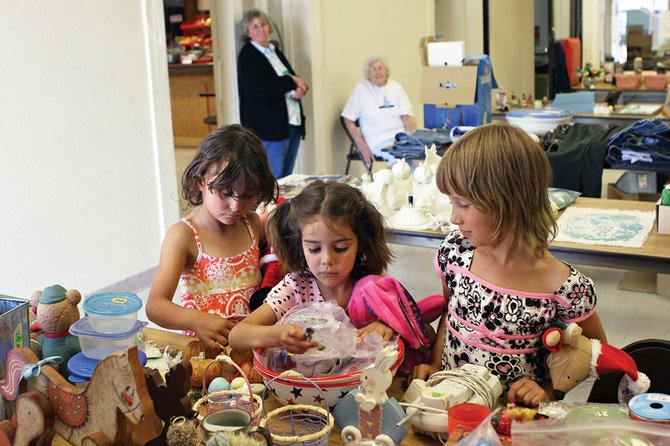 Nichole Dern, 6, left, Danika Cordova, 6, middle, and Alexis Murphy, 8, look over a table of goods during a rummage sale Saturday at the Craig Elks Lodge No. 1577. The sale allowed Elks and community members the opportunity to combine their goods to draw a larger crowd of consumers. Money raised benefited local causes.