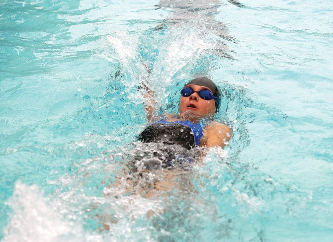 Craig Sea Sharks swimmer Micah Espinosa swims in the backstroke Sunday during the Sea Sharks ABC meet at the Craig Swimming Complex. More than 200 swimmers competed in the three-day swim meet.
