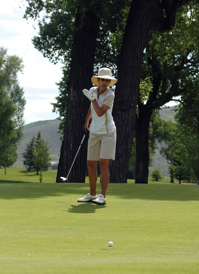 Craig resident Susan Utzinger tries to guide her ball into the cup Saturday at Yampa Valley Golf Course. The golf course hosted the annual Silver Bullet golf tournament Saturday and Sunday. Utzinger finished atop the first flight.