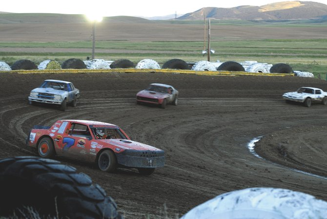 Josh Smith, No. 7, leads the pack in the Super Street race Saturday at Hayden Speedway during the IMCA Modified Showdown. Smith, of Myton, Utah, pulled ahead early and was able to take home the victory.