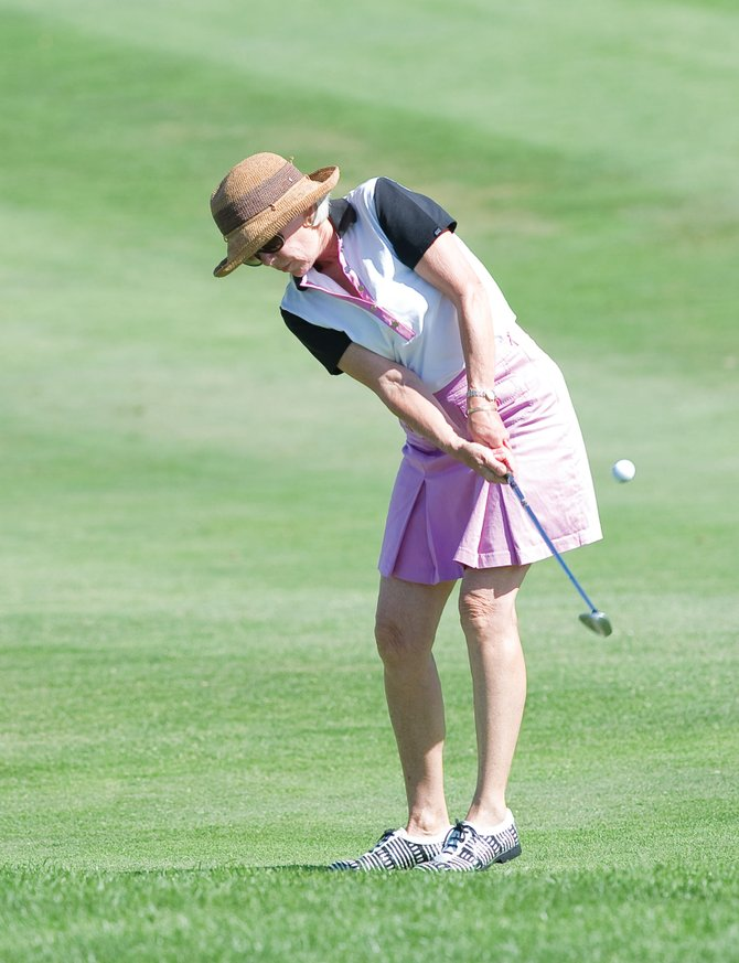 Karla Spooner chips onto the green at the Rally for the Cure golf tournament Tuesday at the Rollingstone Ranch Golf Club. The annual tournament raises money for the Yampa Valley Breast Cancer Awareness Project and the Susan G. Komen Foundation.
