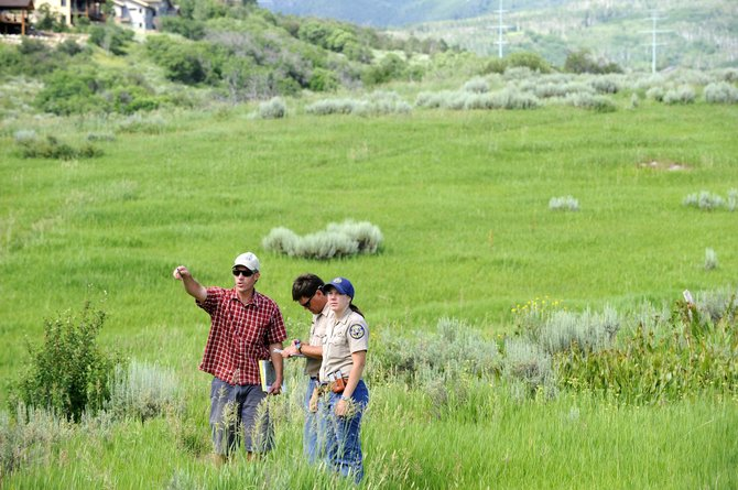Craig Robinson, left, with the city of Steamboat Springs, points out locations of disc golf holes Tuesday at Rita Valentine Park to Colorado Division of Wildlife manager Danielle Domson and aquatic biologist Bill Atkinson. Domson said she plans to write a letter to city officials stating her concerns about wildlife impacts relating to the disc golf course.