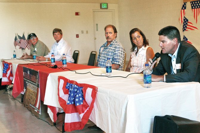 Libertarian Gregory Gilman, of Custer County, right, answers a panel question during a candidate forum hosted by the Moffat County Tea Party on Thursday at the Center of Craig. The forum gave state and federal candidates a platform to express their views to area residents.