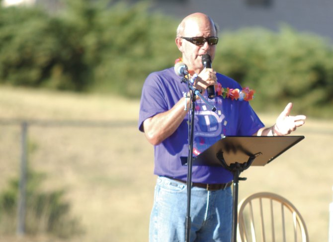 Craig resident Joel Sheridan, 61, gives the survivor speech Friday night during the opening ceremony at the Craig Relay for Life, a fundraiser for the American Cancer Society, at Moffat County High School. Sheridan was diagnosed with prostate cancer three years ago, but is now cancer free.