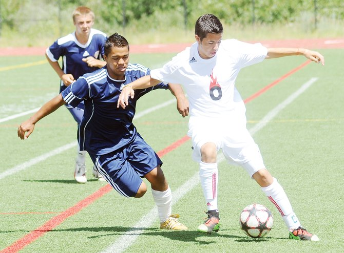 Enrique Lopez pushes for the ball Sunday during the championship game of the U-18 boys Steamboat Mountain Soccer Tournament in Steamboat Springs.