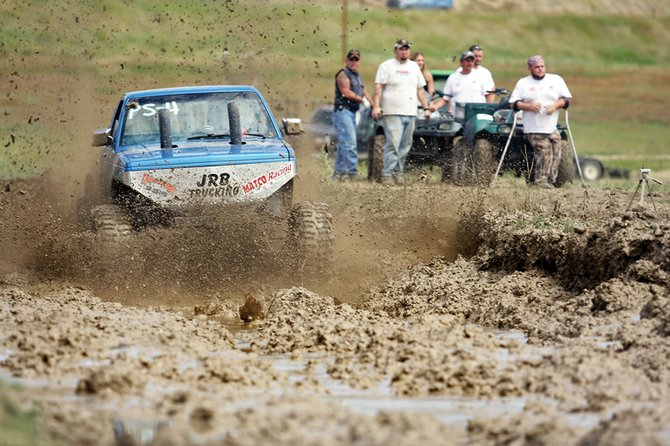 Doug Shepherd slogs through the pit during the second Moffat County Mud Runs of the summer Saturday at the Wyman Museum. Officials said 48 contestants participated in the all-day event.