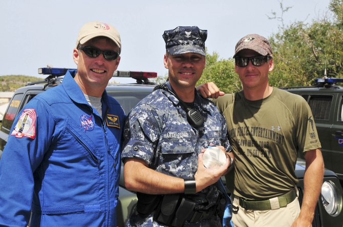 Olympic silver medalist and two-time world champion Todd Lodwick, right, with NASA astronaut Steve Swanson, left, visit with Petty Officer 3rd Class Harty-Perez at the U.S. Naval Station in Guantanamo Bay, Cuba, during Armed Forces Entertainment Heavy Medal II Tour.