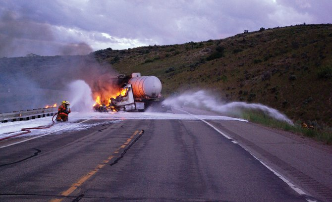 A 1997 Kenworth Tractor caught fire Monday night after a 2010 Ford Escape collided with the vehicle at about 8:20 p.m. on Colorado Highway 13. After impact, the tractor rotated clockwise, jackknifed and came to rest against a guardrail.