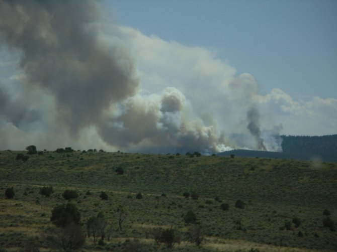 The Logging Fire, shown above from about seven miles out, was reported about 11 a.m. Tuesday and is estimated to be about 300 acres. The fire is burning aggressively on the east side of Douglas Mountain, east of Dinosaur National Monument.