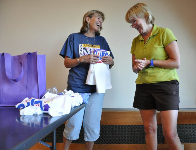 Relay For Life team captain Karen Schulman, left, and volunteer Ann Stein pack Relay For Life T-shirts into gift bags for the team captains at a meeting at Bud Werner Memorial Library on Wednesday. Relay For Life kicks off Friday.