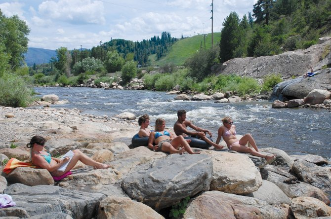 The Yampa River bank was the place to hang out in the sun Friday. Backdoor Sports hosts a river cleanup day followed by pizza and door prizes 9 a.m. until noon Monday.