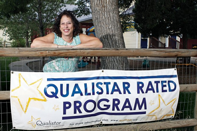 Judi Whilden, owner and director of Sunrise Kids LLC Preschool & Child Care, stands in front of her school on the corner of Seventh and School streets. The program recently received three out of four stars from the Qualistar Early Learning Rating System.
