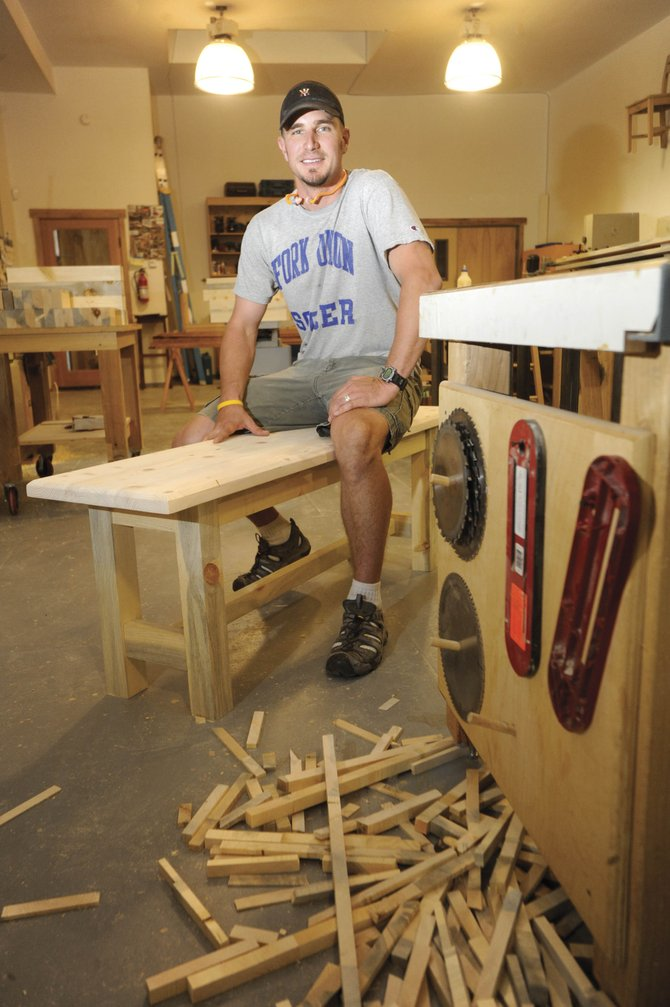 Soroco High School social studies teacher Brad Cooke works in the Dovetail Designs wood shop to construct 10 benches out of blue-stain lodgepole pine that will be put in the school.