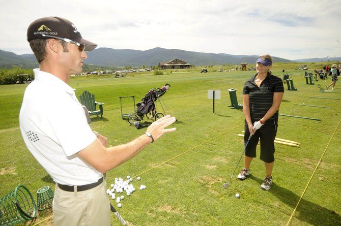 Luke Brosterhous, director of instruction at Haymaker Golf Course, gives a lesson to Alison Swain on Friday. The state of the economy in Steamboat Springs is reflected in a few local indicators, including rounds of golf at Haymaker.