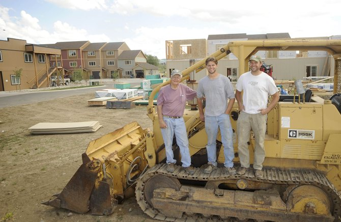 Hayden developers Stefanus Nijsten, right, and his brother Louis, middle, think this site on the west side of town adjacent to their Creek View Townhomes development is suitable for a hotel, which a recent study found there is a demand for. Royce Fulmer, left recently joined the development team.
