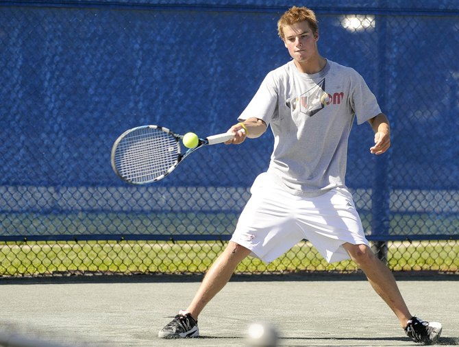 Luke Farney hits a shot during his Summer Tennis Championships match Saturday against Mirko Erspamer.