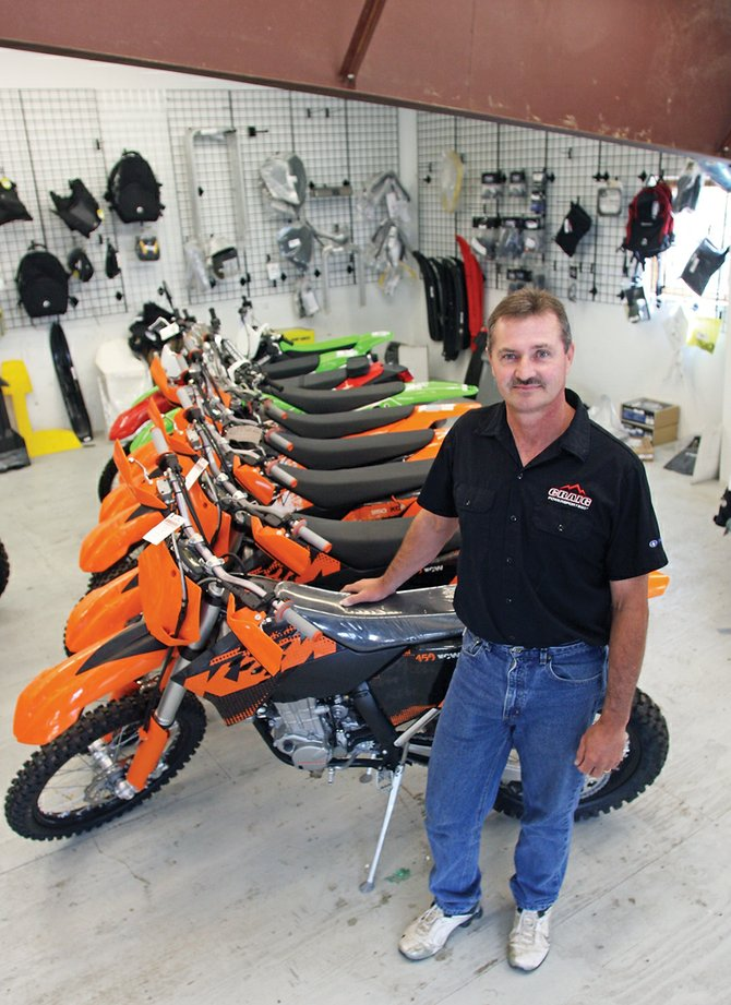 Kevin Willbanks, general manager of Craig Powersports, stands in the dirt bike showroom Friday at the store east of Craig on U.S. Highway 40.
