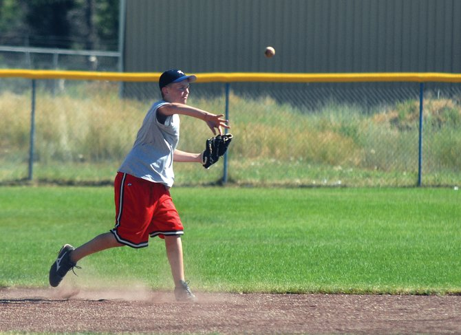 Colten Yoast fires the ball to first base during Moffat County American Legion Post 62 baseball practice Monday. The Bulldogs are competing in the American Legion state tournament, which begins at 9 a.m. Thursday at Craig Middle School, 915 Yampa Ave.